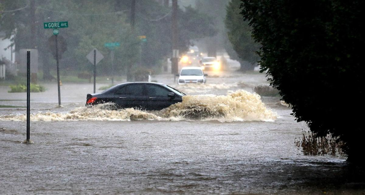 Flooded Street with Car in Middle